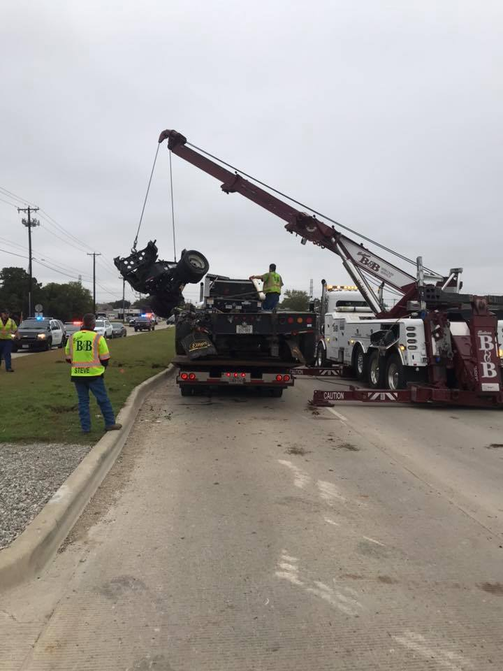 Towing damaged 18-wheeler flatbed after hit by TRE train