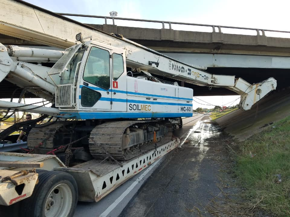 Drilling rig stuck under bridge at 820 and Highway 10.